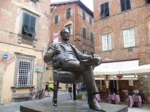 Puccini outside his house